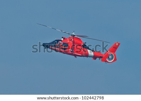 SAN FRANCISCO, CA - OCTOBER 9: USCG Helicopter Eurocopter HH-65 Dolphin demonstration during 2011 San Francisco Fleet Week on October 9, 2011 in San Francisco, CA. - stock photo