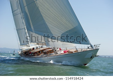 SAN FRANCISCO, CA - SEPTEMBER 13: A super yacht competes in a regatta during the America's Cup in San Francisco, CA on September 13, 2013 - stock photo