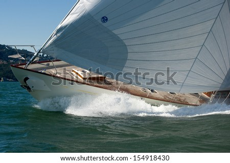 SAN FRANCISCO, CA - SEPTEMBER 13: Super yacht Kealoha competes in a regatta during the America's Cup in San Francisco, CA on September 13, 2013 - stock photo