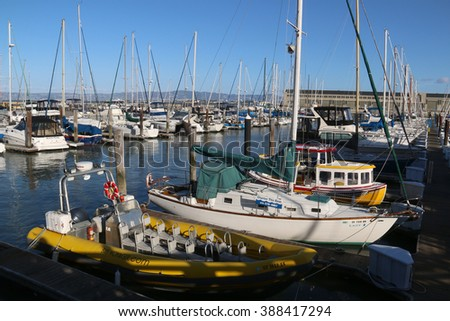 San Francisco, CA, USA - December 23, 2015: Pier 39 houses a 300-berth marina by the bay with double-fingered wooden dock boat slips for long-term rental, day stays and overnight guest docking.