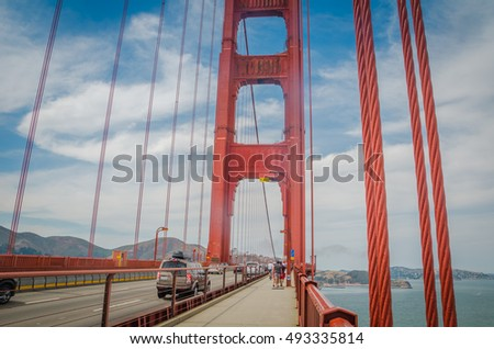 SAN FRANCISCO, CA,USA - 2015, JULY 1: Golden Gate bridge with cars, trucks, buses, pedestrians and cyclists and fog