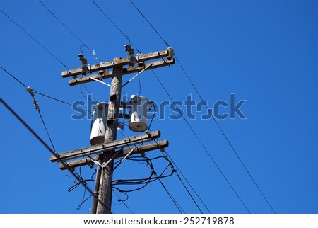 San Francisco, California - June 19 2011: Wooden Electrical Post along the road in the city. - stock photo