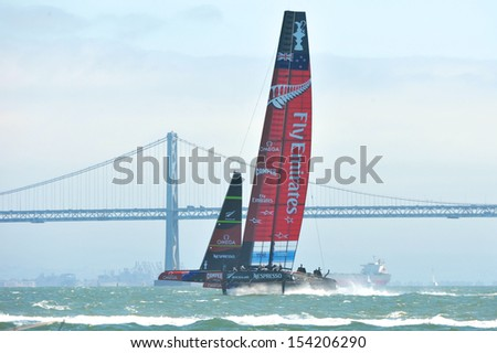SAN FRANCISCO, CALIFORNIA � SEPTEMBER 14: Oracle Team USA and New Zealand sail at high speed during the finals race 8 at the America�s Cup Finals on September 14, 2013 in San Francisco, California.   - stock photo