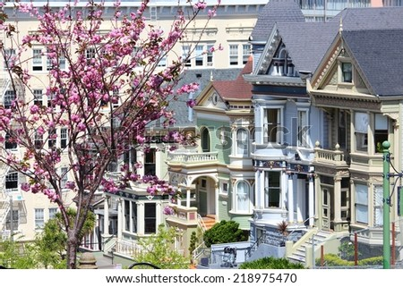 San Francisco, California, United States - city view with famous Painted Ladies, Victorian homes at Alamo Square (Western Addition neighborhood). - stock photo