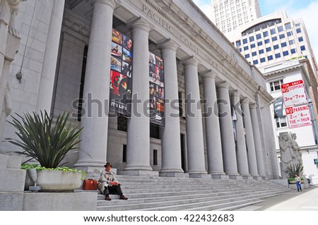 San Francisco, California, Usa: a man seated on the stairs of Pacific Stock Exchange building on June 13, 2010. The Pacific Exchange was a regional stock exchange in California until 2001