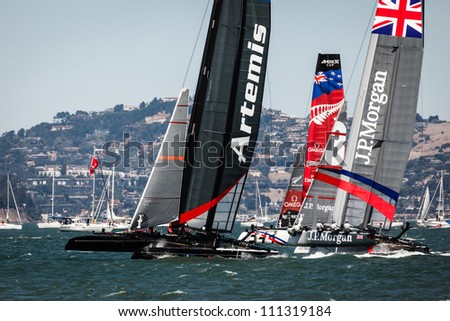 SAN FRANCISCO, CALIFORNIA, USA - AUGUST 25, 2012: Cluster of competitors in the America's Cup Sailing races for Louis Vuitton Cup on August 25, 2012 in San Francisco Bay, California - stock photo