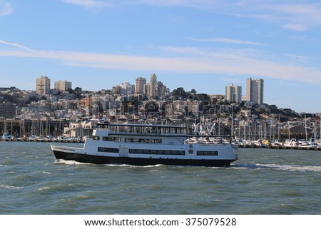 San Francisco, California, USA - December 23, 2015: Alcatraz Cruise is the nation's first hybrid ferry, the eco friendly vessel powered by solar panels, wind turbines, and grid electricity.