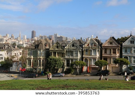 San Francisco, California, USA - December 24, 2015: Painted Ladies across from Alamo Square park, known as Postcard Row, often appears in media and mass-market photographs of the city.