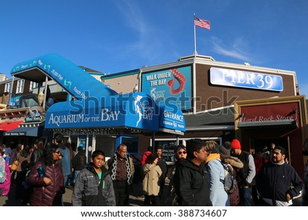 San Francisco, California, USA - December 23, 2015: Pier 39 is a popular tourist attraction with shops, restaurants, street performance, Aquarium of the Bay and marina in San Francisco, California.