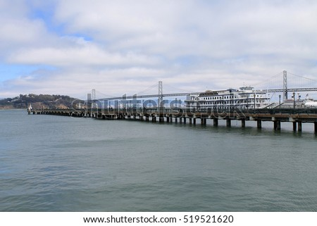SAN FRANCISCO,CALIFORNIA,USA - MAY 26,2015: Pier view with vintage ship in port of San Francisco with Oakland Bridge at the background