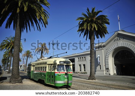 SAN FRANCISCO, California, USA, - NOVEMBER. 10. 2011: Streetcar running on the street trail, propelled by electric motors and a trolley pole to draw power from an overhead, San Francisco