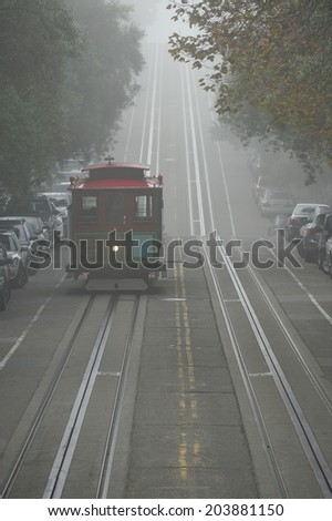 SAN FRANCISCO, California, USA, - NOVEMBER. 8. 2011: The Cable car tram in the fog, San Francisco, world's last manually-operated cable car system, icon of San Francisco - stock photo