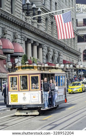 San Francisco, California, USA - November 12, 2013: The San Francisco cable car system against the backdrop of the American flag. - stock photo