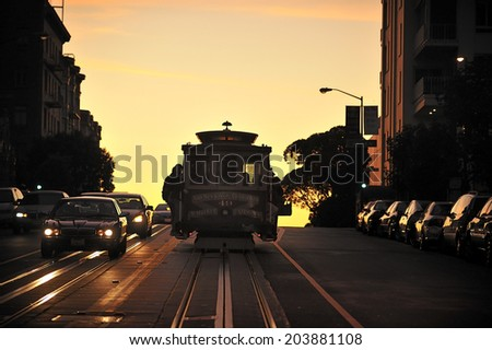SAN FRANCISCO, California, USA, - NOVEMBER. 8. 2011: The silhouette of cable car tram in San Francisco, world's last manually-operated cable car system, icon of San Francisco - stock photo