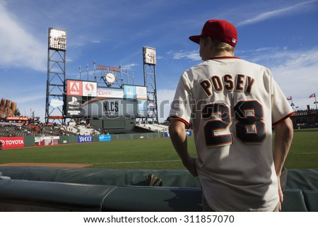 San Francisco, California, USA, October 16, 2014, AT&T Park, baseball stadium, SF Giants versus St. Louis Cardinals, National League Championship Series (NLCS), fan with Posey #28 uniform pre-game - stock photo