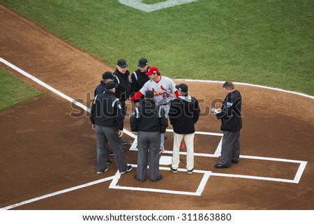 San Francisco, California, USA, October 16, 2014, AT&T Park, SF Giants versus St. Louis Cardinals, National League Championship Series (NLCS), Umpires and Manager Mike Matheney, Cardinals homeplate - stock photo