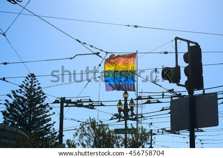 San Francisco, California, USA - September 17, 2013:This rainbow flag flies in the heart of the Castro District in San Francisco. The Castro is a draw for the LGBT community, particularly gay men. - stock photo