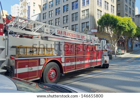 SAN FRANCISCO - CIRCA AUGUST 2012: Fire truck in action, San Francisco, circa August 2012. The SFFD serves a population of 1.4 million people with approximately 1,700 field personnel - stock photo