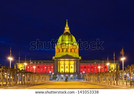 San Francisco City Hall in red and gold light. - stock photo