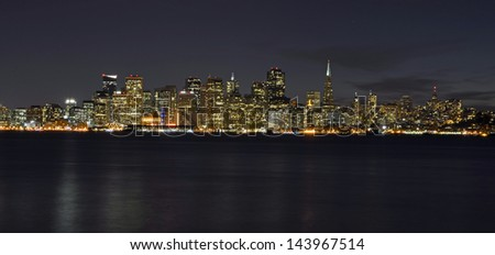 San Francisco City Shoreline Buildings and Lights at Night Across Water