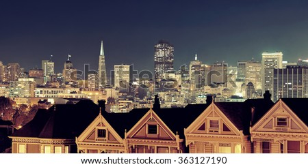 San Francisco city skyline with urban architectures at night from Alamo Square. - stock photo