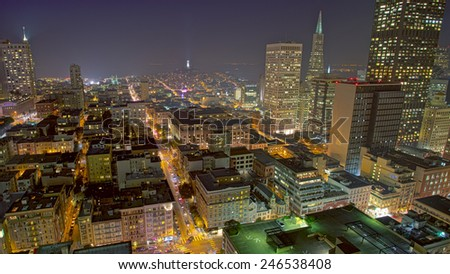 San Francisco cityscape with a view of famous skyscrapers and landmarks with city lights at night - stock photo