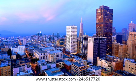 San Francisco cityscape with a view of famous skyscrapers and landmarks with colorful clouds at dusk - stock photo