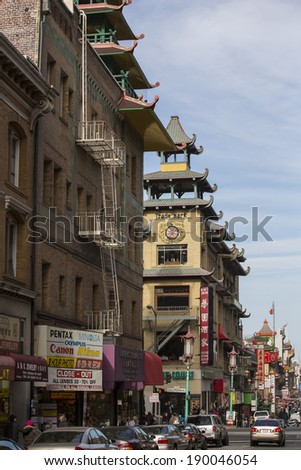 SAN FRANCISCO - DECEMBER 31: Daytime at Chinatown on December 31,  2013 in San Francisco, USA. San Francisco's Chinatown is one of North America's largest Chinatowns. - stock photo