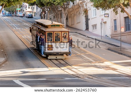 SAN FRANCISCO - FEB 25: Famous Cable Car near Union Square on February 25, 2008 in San Francisco, California. Cable car trains first began operating in the city in 1873. - stock photo