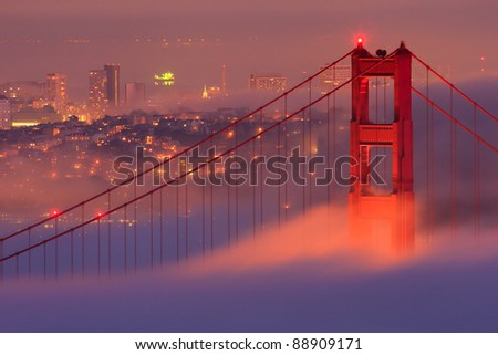 San Francisco Golden Gate Bridge in fog - stock photo
