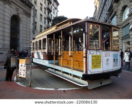 SAN FRANCISCO - JANUARY 3: Antique Cable Car on Powell Street Turntable as the car is turned around on January 3, 2011 in San Francisco, California, USA.  - stock photo