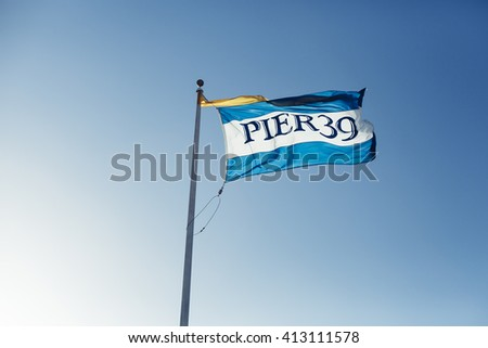 SAN FRANCISCO - JULY 2, 2014: Pier 39 flag blowing in the wind
