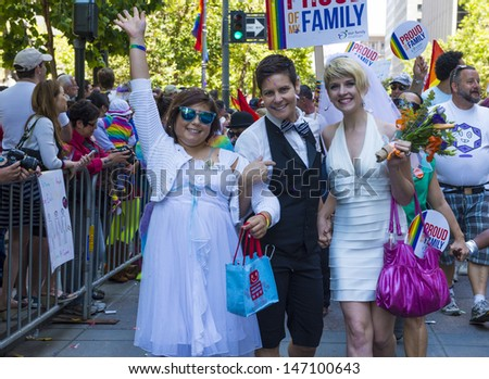 SAN FRANCISCO -  JUNE 30 : An unidentified Lesbian couple with there daughter participates at the annual San Francisco Gay pride parade on June 30 2013
