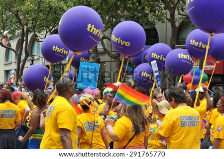 SAN FRANCISCO - JUNE 28: Paraders on Market Street in the SF Pride Parade enjoy the day on June 28, 2015 - stock photo