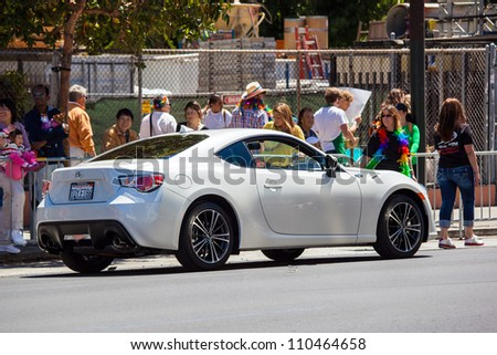 SAN FRANCISCO - JUNE 24: The new 2012 model of Toyota F86 as a part of San Francisco Gay Pride Parade 2012. June 24, 2012 in San Francisco - stock photo