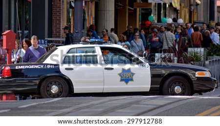 SAN FRANCISCO - MAY 17 2015:Modern SFPD cruiser in Powell St. San Francisco California.According to  San Francisco Police records, thefts and robberies crime is at high since 2008.  - stock photo