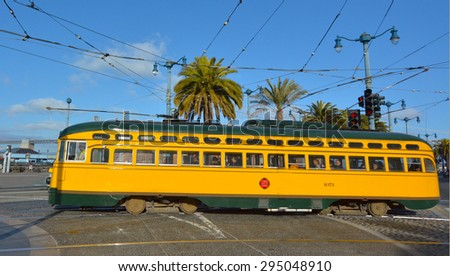 SAN FRANCISCO - MAY 15 2015:One of San Francisco's original double-ended PCC streetcars.In 2006, it served 46.7 square miles (121 km2) with an operating budget of about $700 million - stock photo