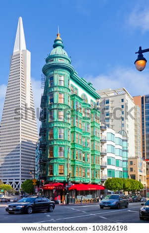 SAN FRANCISCO -MAY 26: Transamerica and Flatiron buildings in San Francisco on May 26, 2012. The city approved a cluster of high rises south of Market Street that will dwarf the Transamerica building. - stock photo