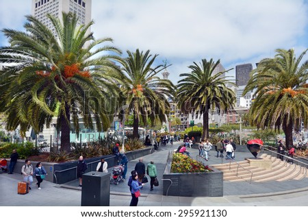 SAN FRANCISCO - MAY 15 2015:Visitors at San Francisco Union Square.It's a major tourist attraction gathering place in downtown San Francisco  one of the world's premier shopping districts - stock photo