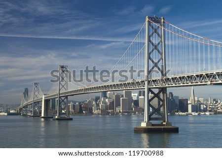 SAN FRANCISCO - NOVEMBER 2:Bay Bridge, November 2, 2012 in San Francisco. Bridge was opened for traffic on 1936 and carries 270,000 vehicles per day. It has one of the longest spans in the world. - stock photo