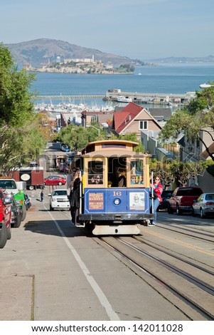 SAN FRANCISCO - NOVEMBER 2: Cable car tram, November 2nd, 2012 in San Francisco, USA. It is world last permanently manually operated cable car system. Lines were established between 1873 and 1890. - stock photo
