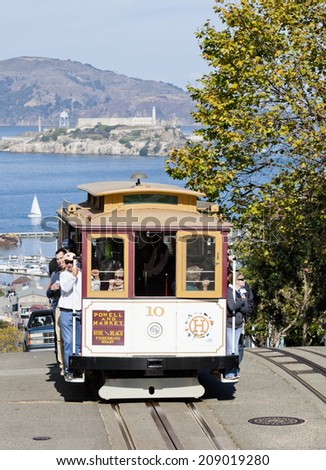 SAN FRANCISCO - NOVEMBER 2nd: The Cable car tram, November 2nd, 2012 in San Francisco, USA. The San Francisco cable car system is world last permanently manually operated cable car system. - stock photo