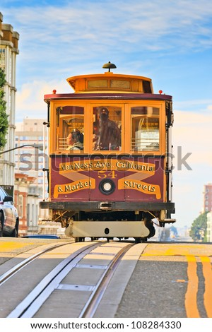 SAN FRANCISCO - NOVEMBER 26, 2010: Passengers enjoy a ride in a cable car in San Francisco, California. Nov 26, 2010. It is the oldest mechanical public transport in San Francisco which is in service since 1873. - stock photo