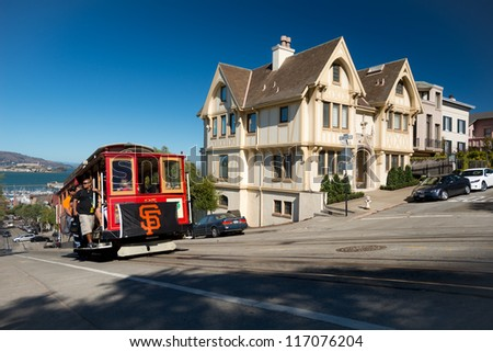 SAN FRANCISCO - OCT 16: A San Francisco Giants flag is hung on the iconic street cable car in support of the Giants: World Series 2012 champions on Oct 16, 2012 in San Francisco, USA - stock photo