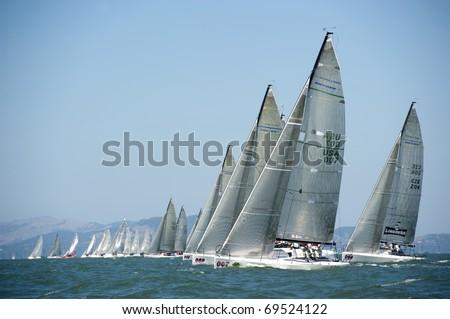 SAN FRANCISCO - SEPT 23: Melges 32 World Championship, Sept 23, 2010, San Francisco bay. Q, sail #007, pulling ahead at the start of race 1. - stock photo