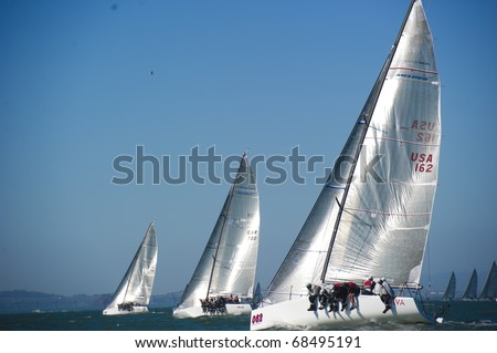 SAN FRANCISCO - SEPT 25: Melges 32 World Championship, Sept 24, 2010, San Francisco bay. the fleet at the start of  8th race. - stock photo