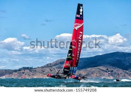 SAN FRANCISCO-SEPT 25: New Zealand foils with both hulls out of the water in the final race with Oracle Team USA on Sept. 25, 2013 in San Francisco. USA won by 44 seconds in a historic comeback. - stock photo