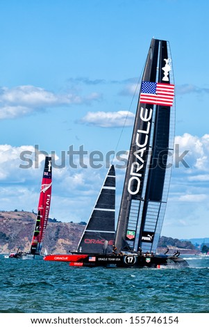 SAN FRANCISCO-SEPT 25: Oracle Team USA beats New Zealand to take the America's Cup title in the final historic race on Sept. 25, 2013 in San Francisco. USA wins by 44 seconds. - stock photo