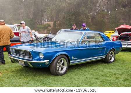 SAN FRANCISCO - SEPTEMBER 29: A 1968 Ford Mustang Coupe is on display during the 2012 Jimmy's Old Car Picnic in Golden Gate Park in San Francisco on September 29, 2012 - stock photo
