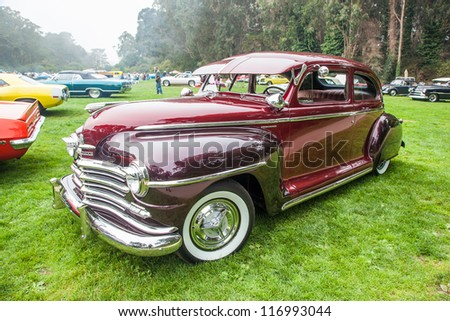 SAN FRANCISCO - SEPTEMBER 29: A 1948 Plymouth Special Deluxe is on display during the 2012 Jimmy's Old Car Picnic in Golden Gate Park in San Francisco on September 29, 2012 - stock photo